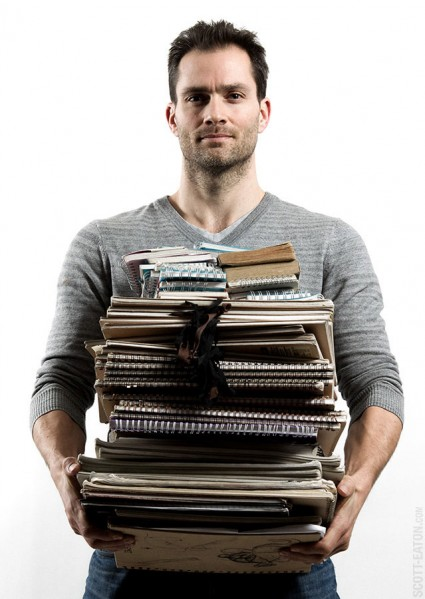 Scott with five years of sketchbooks
